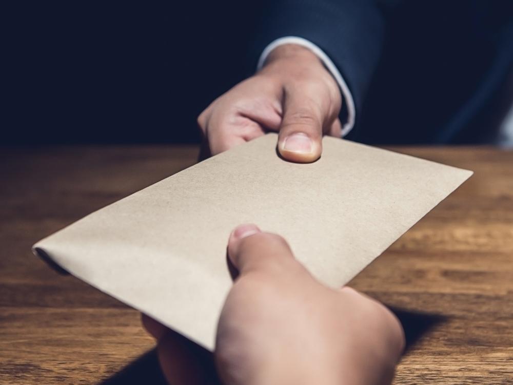 Corruption, Handing over Envelope