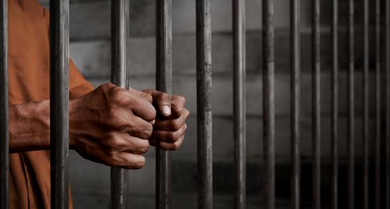 Prison, Man Gripping Bars