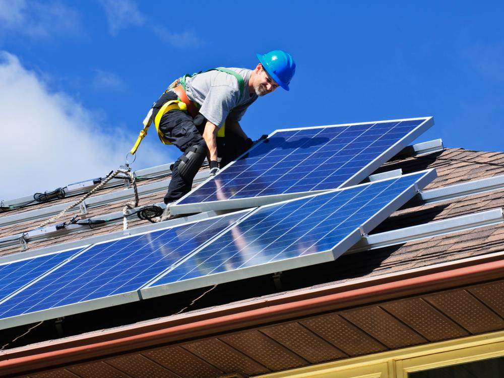 Man Installing Rooftop Solar Panels