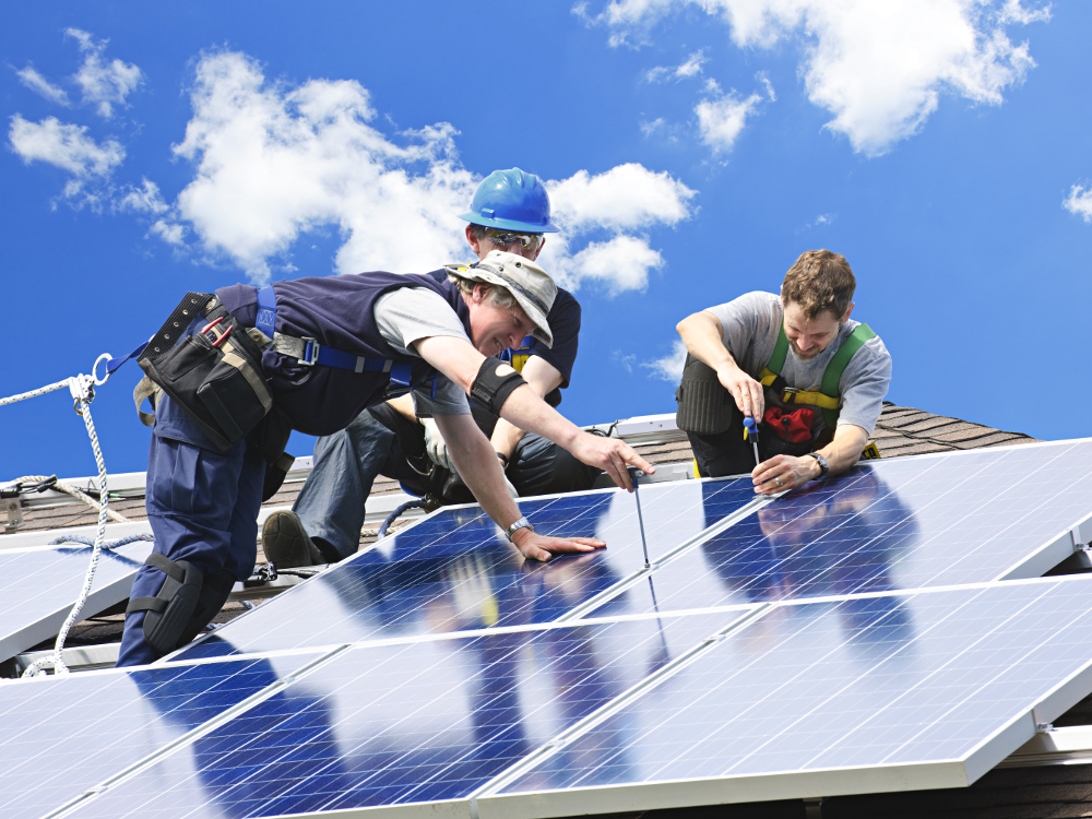 Three Workers Installing Rooftop Solar Panels